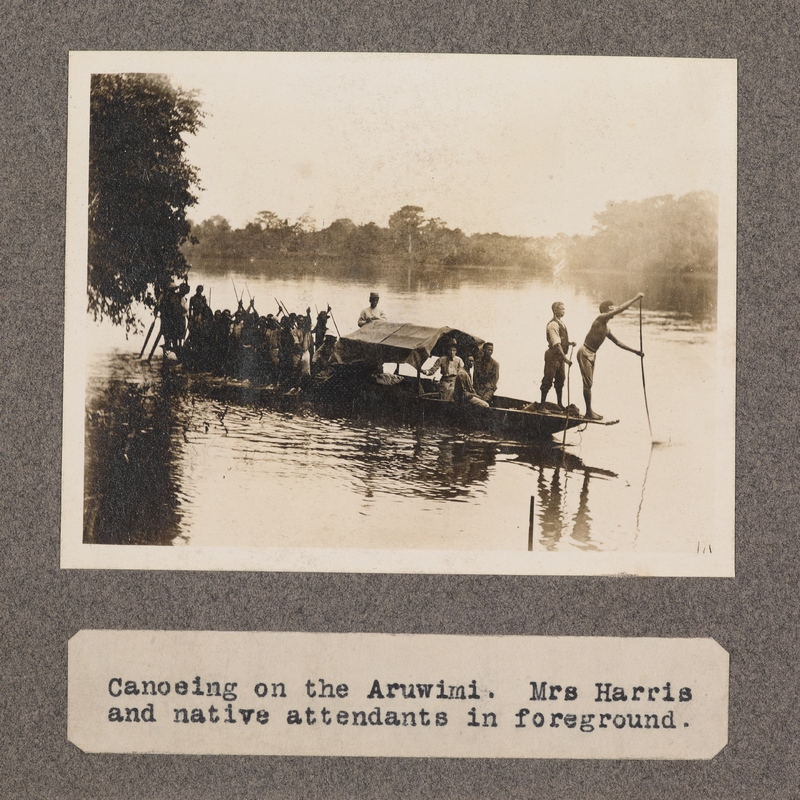 Canoeing on the Aruwimi. Mrs. Harris and native attendants in foreground