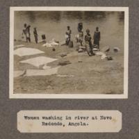 Women washing in river at Novo Redondo, Angola