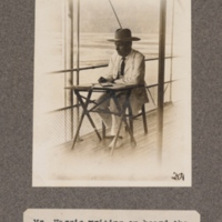 Mr. Harris writing on board the S. S. Lapsley, Kasai River