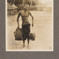 Native of Kasai District, with his loads of rubber for sale