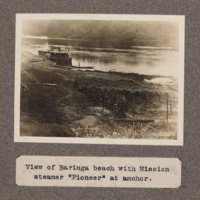 View of Baringa beach with mission steamer Pioneer at anchor