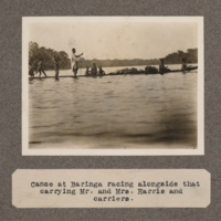 Canoe at Baringa racing alongside that carrying Mr. and Mrs. Harris and carriers